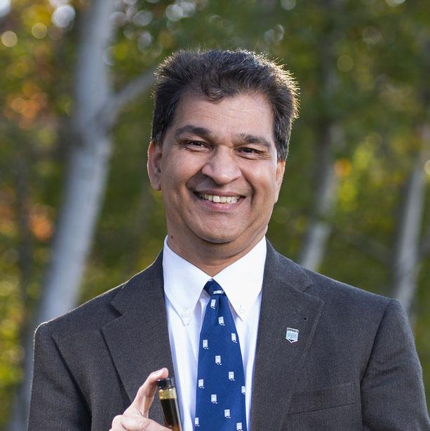 FBRI director Hemant Pendse wearing a white shirt, dark jacket, royal blue tie