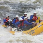 Students paddling in rapids